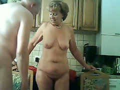 Granny & hubby have enjoyment in the kitchen