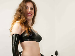 Slut in latex bonks herself encircling sex outfit